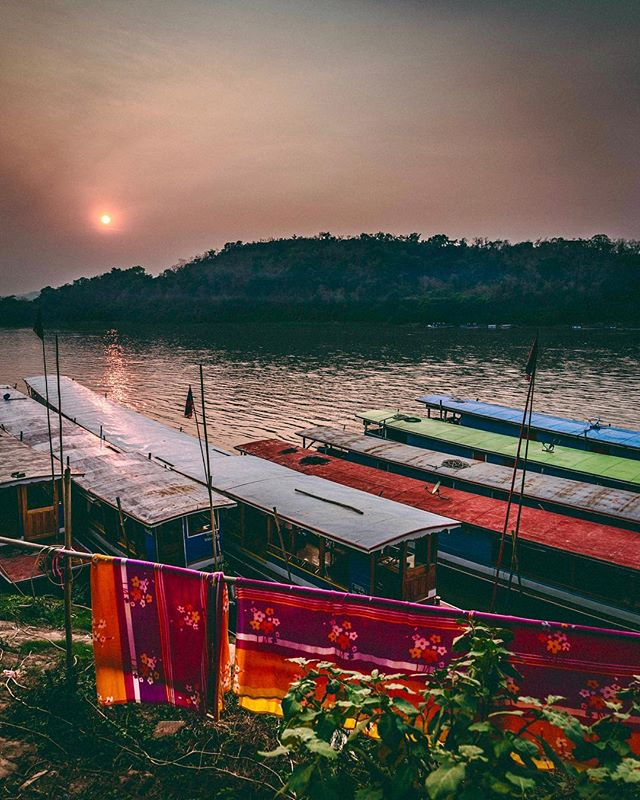 Twice we aimlessly found our way to the Mekong River in Luang Prabang at the perfect time to spontaneously rent one of these amazing boats. We'd silently float, the boat all to ourselves, grateful for Laos' impossibly long sunsets. . . . . . #photography #documentaryphotography #photooftheday #portraitphotography #portrait #portraits #sonya7riii #lao #ig_travel #laos🇱🇦 #streets_storytelling #travelphotography #travelgram  #photo_dailydose #ig_respect #globe_portraits #theportraitpr0ject #earth_portraits #remoteexpeditions #natgeohumanity #humanity_shots_ #_souloftheworld #thestreetphotographyhub #fivestars_people #sunset_madness_ #nature_of_our_world #mekongriver #boatlife