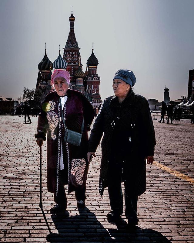 Moscow's Red Square is surrounded by a mix of churches (like Saint Basil's Cathedral), Lenin's (embalmed) tomb, the Kremlin, Putin's official residence... and for a moment, home to these two beautiful women who seemed very happy to be wandering through its center. . . . . . #photography #documentaryphotography #photooftheday #portraitphotography #portrait #portraits #sonya7riii #moscow #ig_travel #moscow_ig #streets_storytelling #travelphotography #travelgram  #photo_dailydose #ig_respect #globe_portraits #theportraitpr0ject #russian #redsquare #natgeohumanity #humanity_shots_ #_souloftheworld #thestreetphotographyhub #fivestars_people #lenin #nature_of_our_world #cathedral #girlstrip