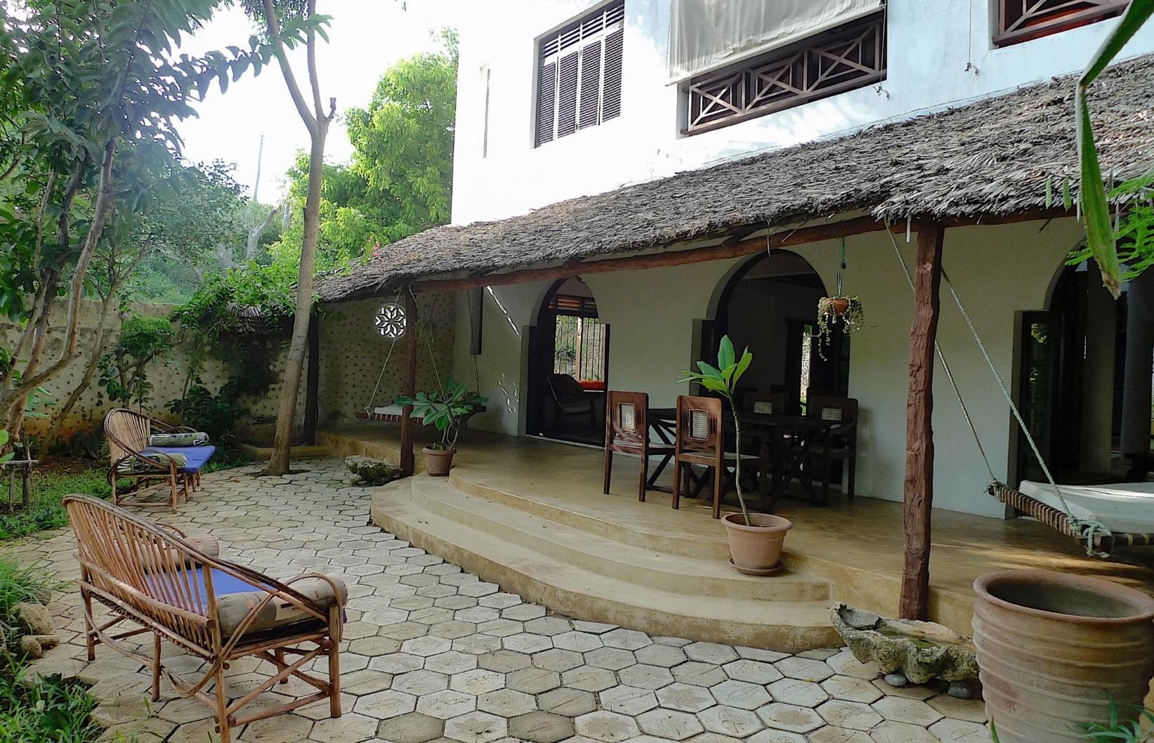 Garden terrace with breakfast table