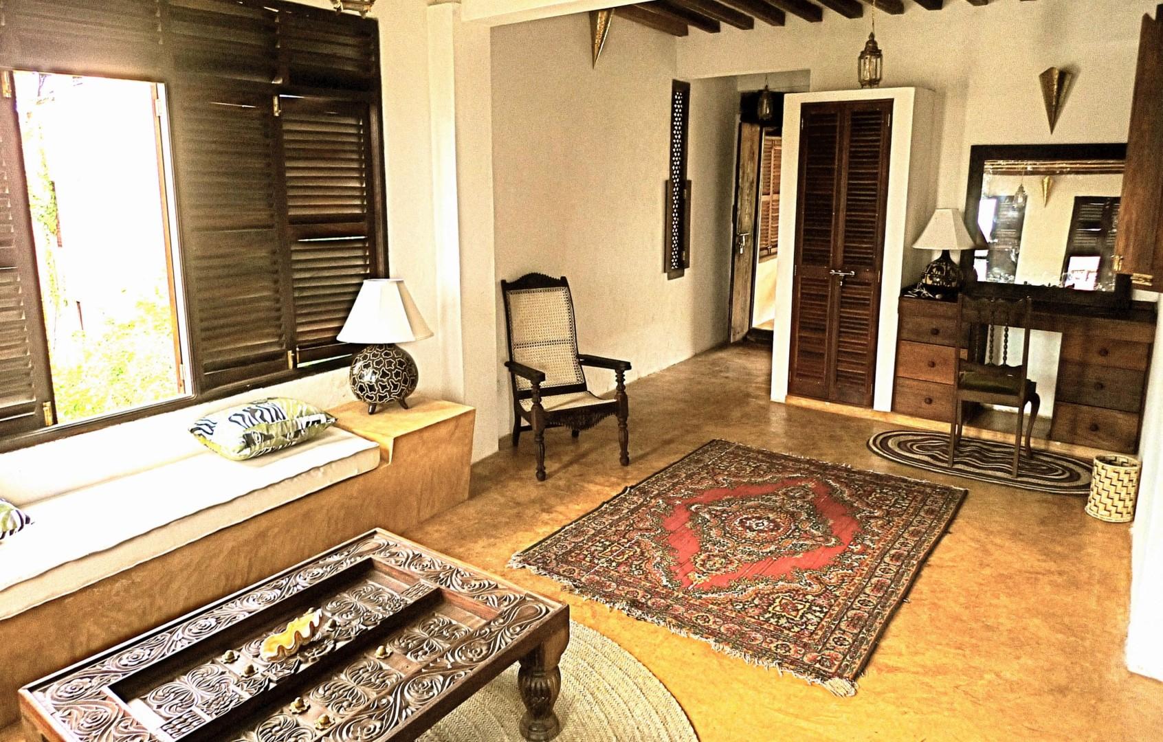 Suite sitting area with door to balcony day-room