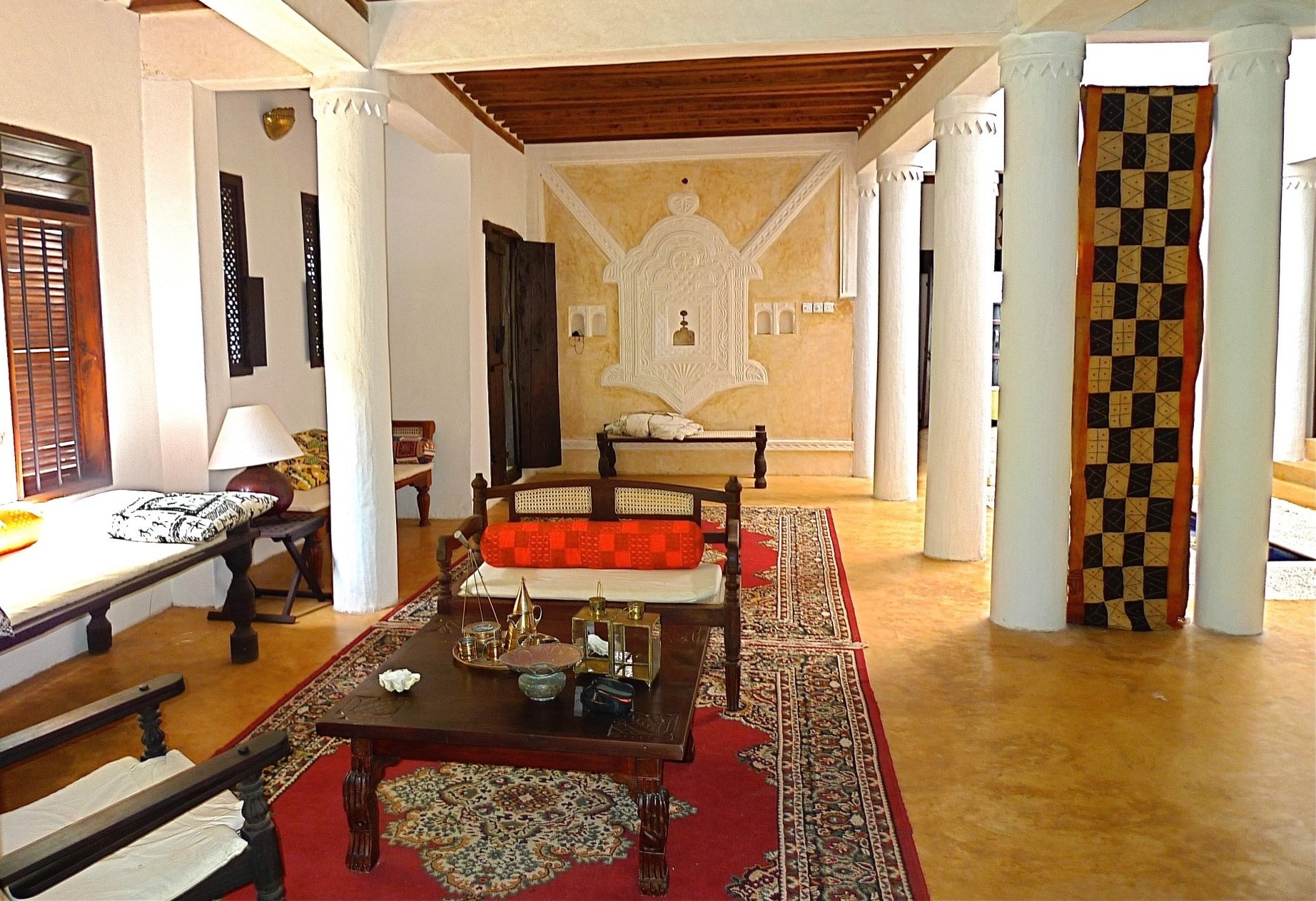 Lounging area with traditional stucco and alcove work