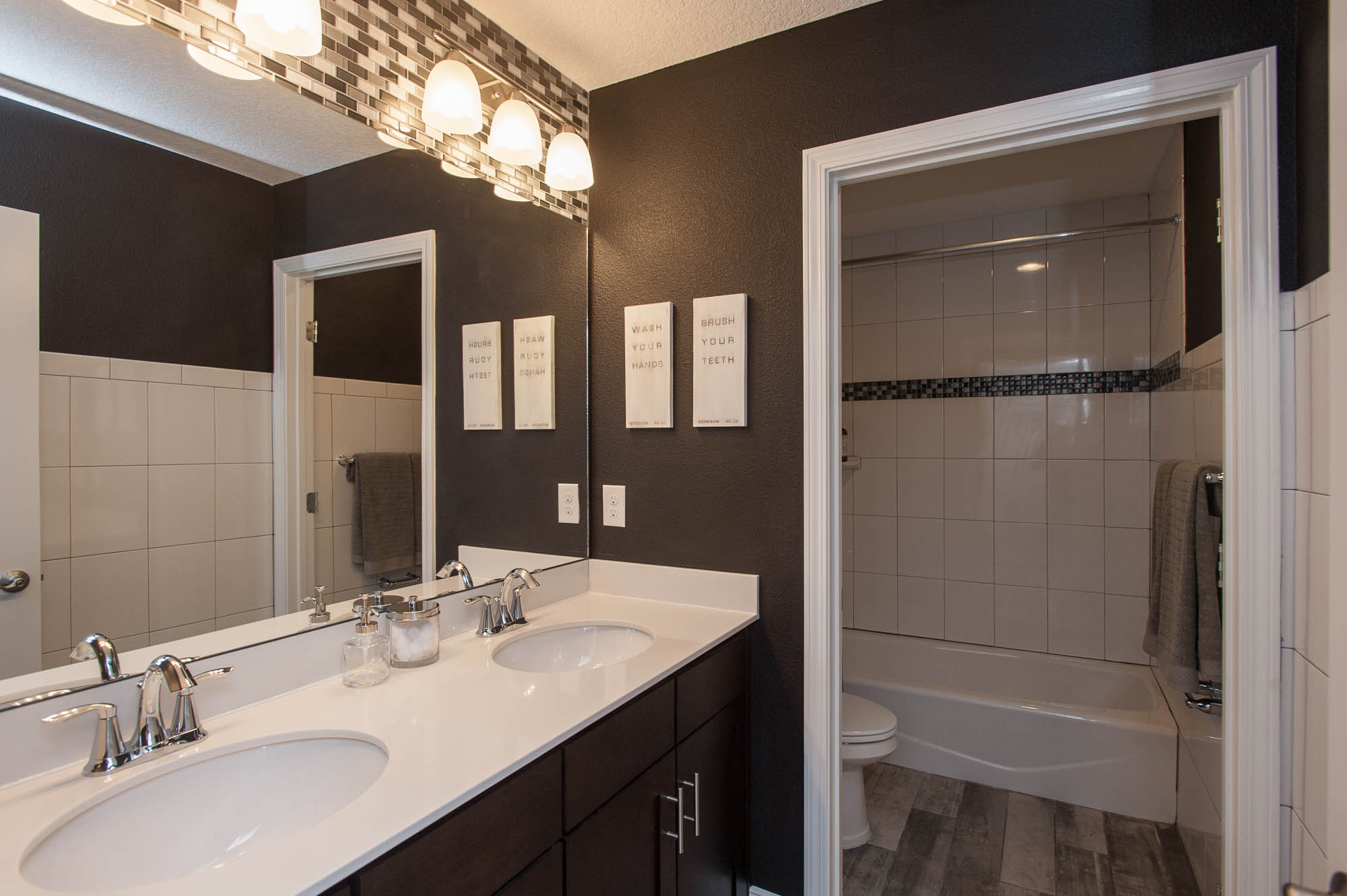 dayton-dr-horton-dr horton-st johns-jacksonville-florida-nefba-northeast florida-southeastern united states-residential interior design-transitional-bathroom-double vanity-shower-white tile-.jpg