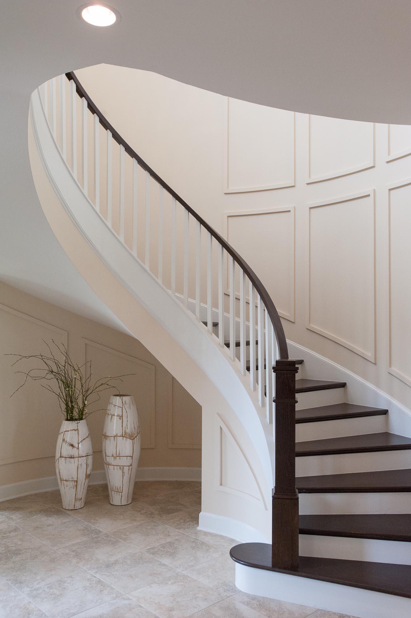 sterling-lennar-celestina-st johns-florida-nefba-northeast florida-southeastern united states-residential interior design-entry-contemporary-staircase-spiral staircase-millwork-planter.jpg