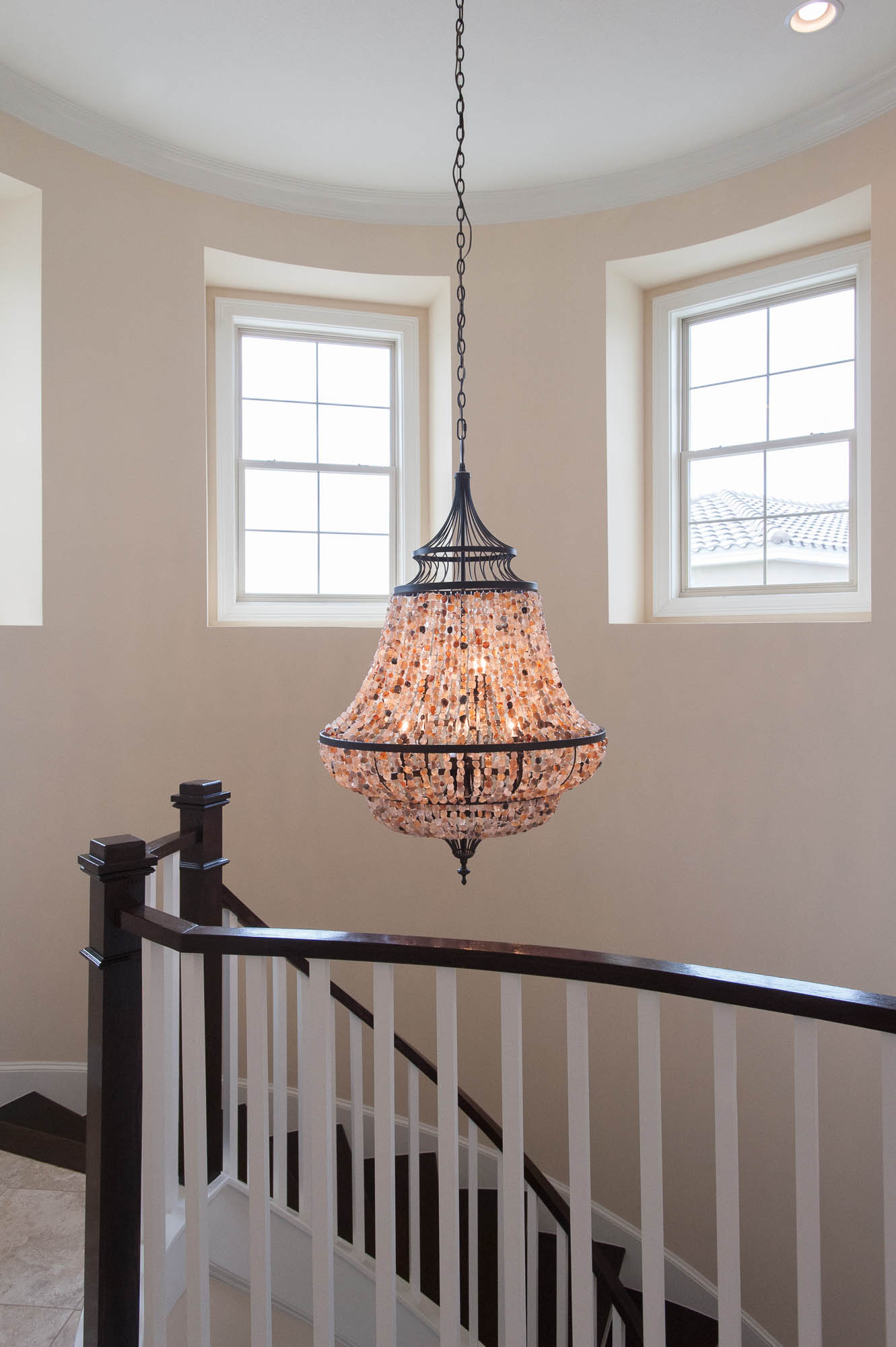 sterling-lennar-celestina-st johns-florida-nefba-northeast florida-southeastern united states-residential interior design-contemporary-staircase-spiral staircase-millwork-chandelier.jpg