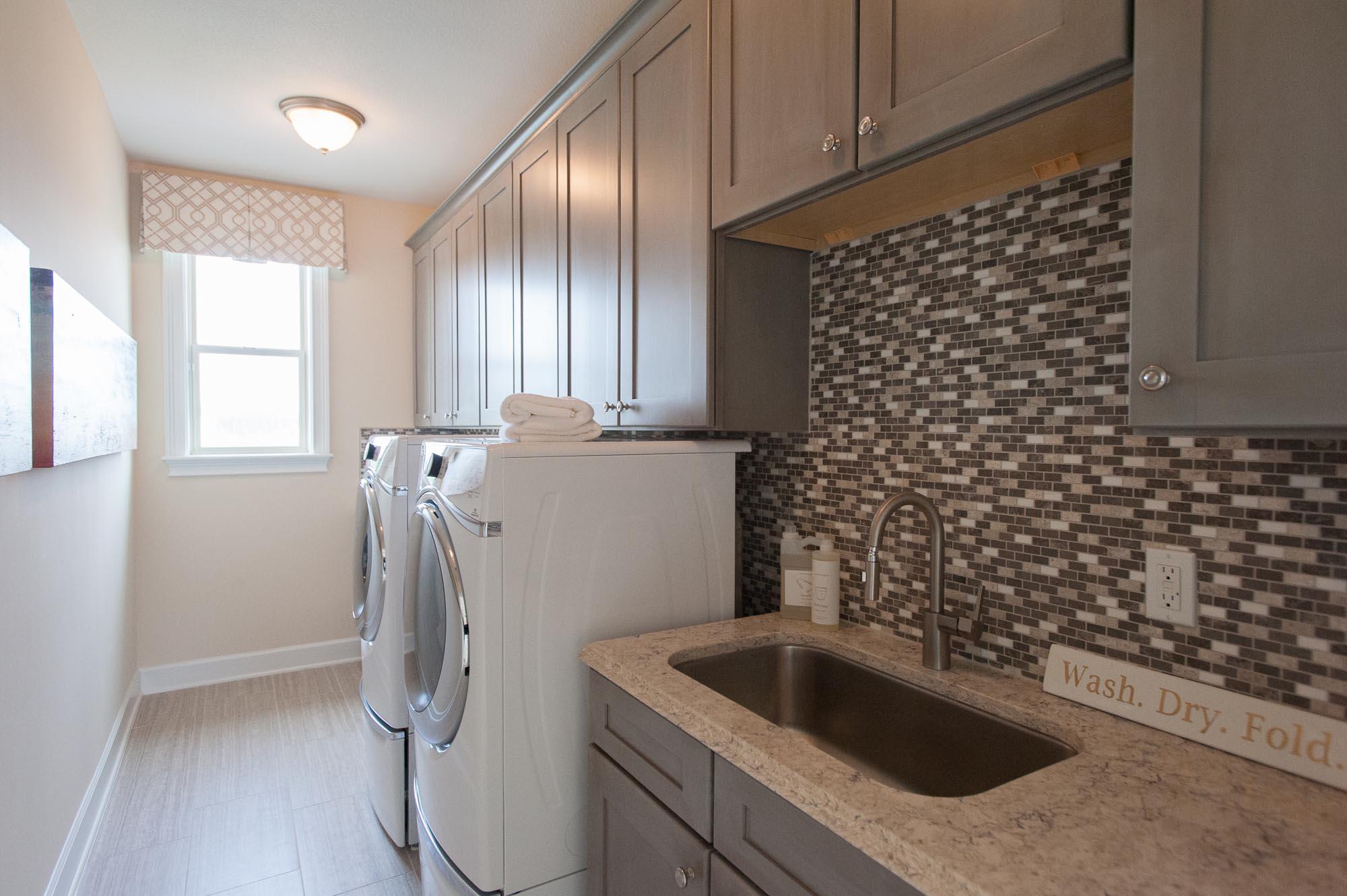 sterling-lennar-celestina-st johns-florida-nefba-northeast florida-southeastern united states-residential interior design-contemporary-transitional-washer-dryer-laundry room.jpg