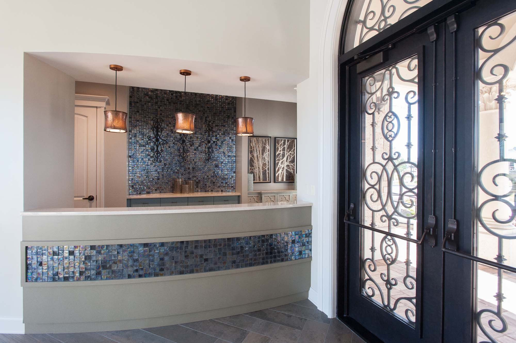 artisan lakes-lennar-ponte vedra-florida-nefba-northeast florida-southeastern united states-commercial interior design-entry-welcome desk-blue glass tile.jpg