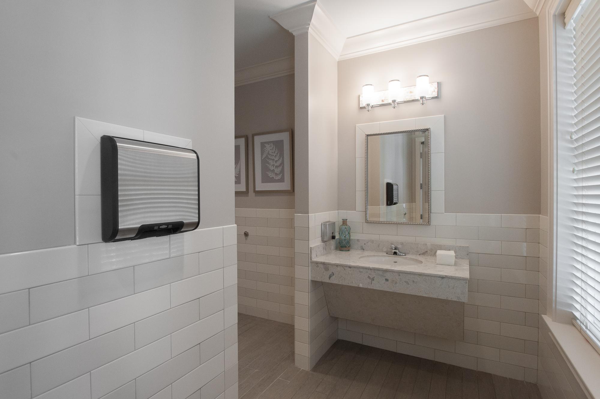 markland-hines-st augustine-florida-nefba-northeast florida-southeastern united states-commercial interior design-licensed interior designer-manor-interior design florida-restroom-pool bath-bathroom-ADA-white-dyson-restroom wainscot.jpg
