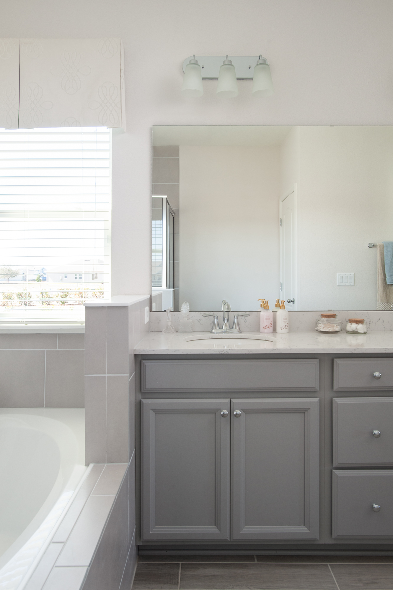 Micamy_Interior Designer_Design_Interior_Model_Merchandising_Owners_Suite_Universal_Furniture_Traditional_Transitional_Bathroom_Vanity_Grey_Cabinets_Bath.jpg