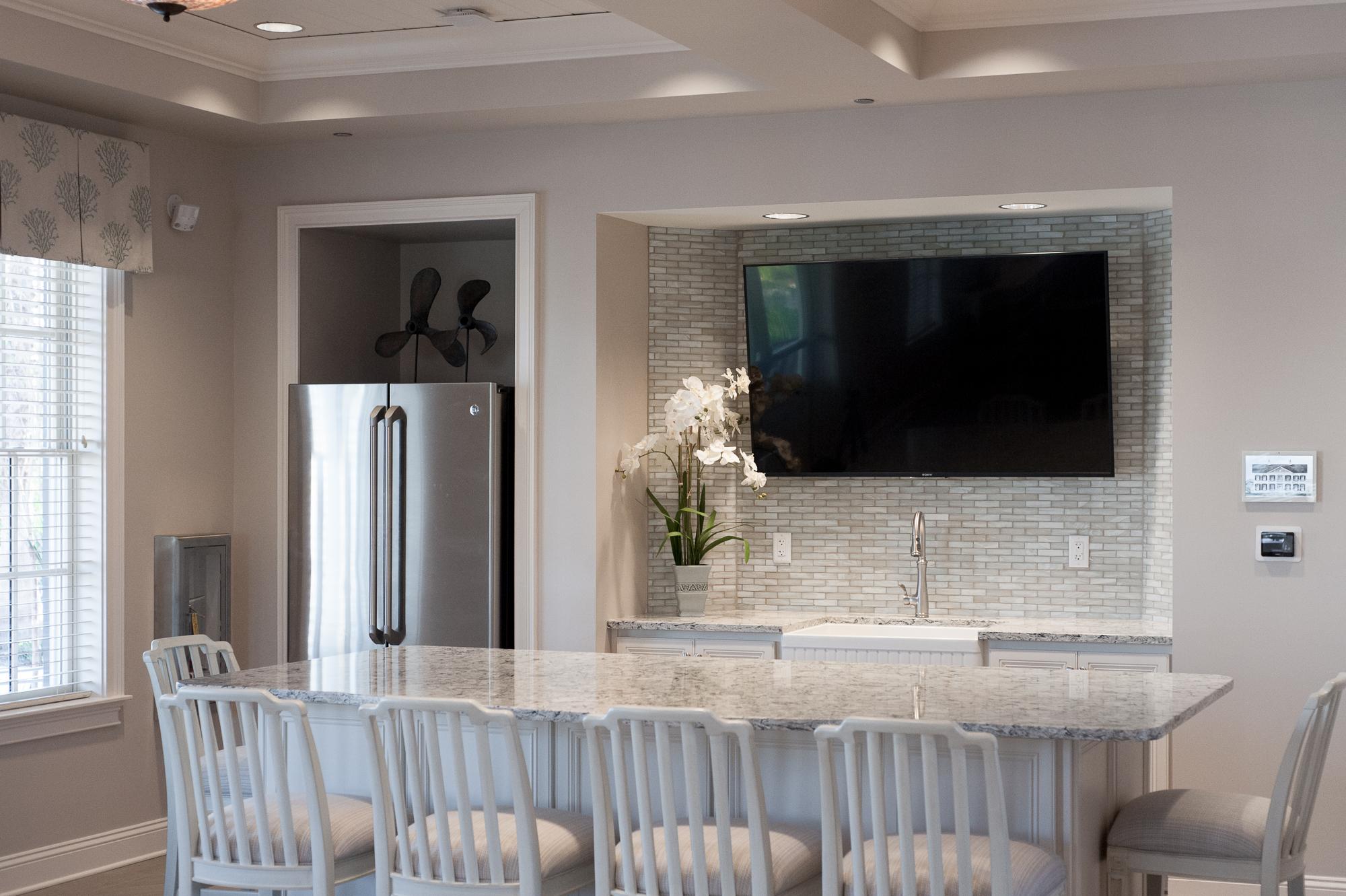 Micamy_Design_Studio_Interior_Design_Markland_StAugustine_Clubhouse_OldFlorida_Coastal_Glass_Mosaic_Tile_Backsplash_Kitchen_Cambria_Kohler_Blue_ (3).jpg
