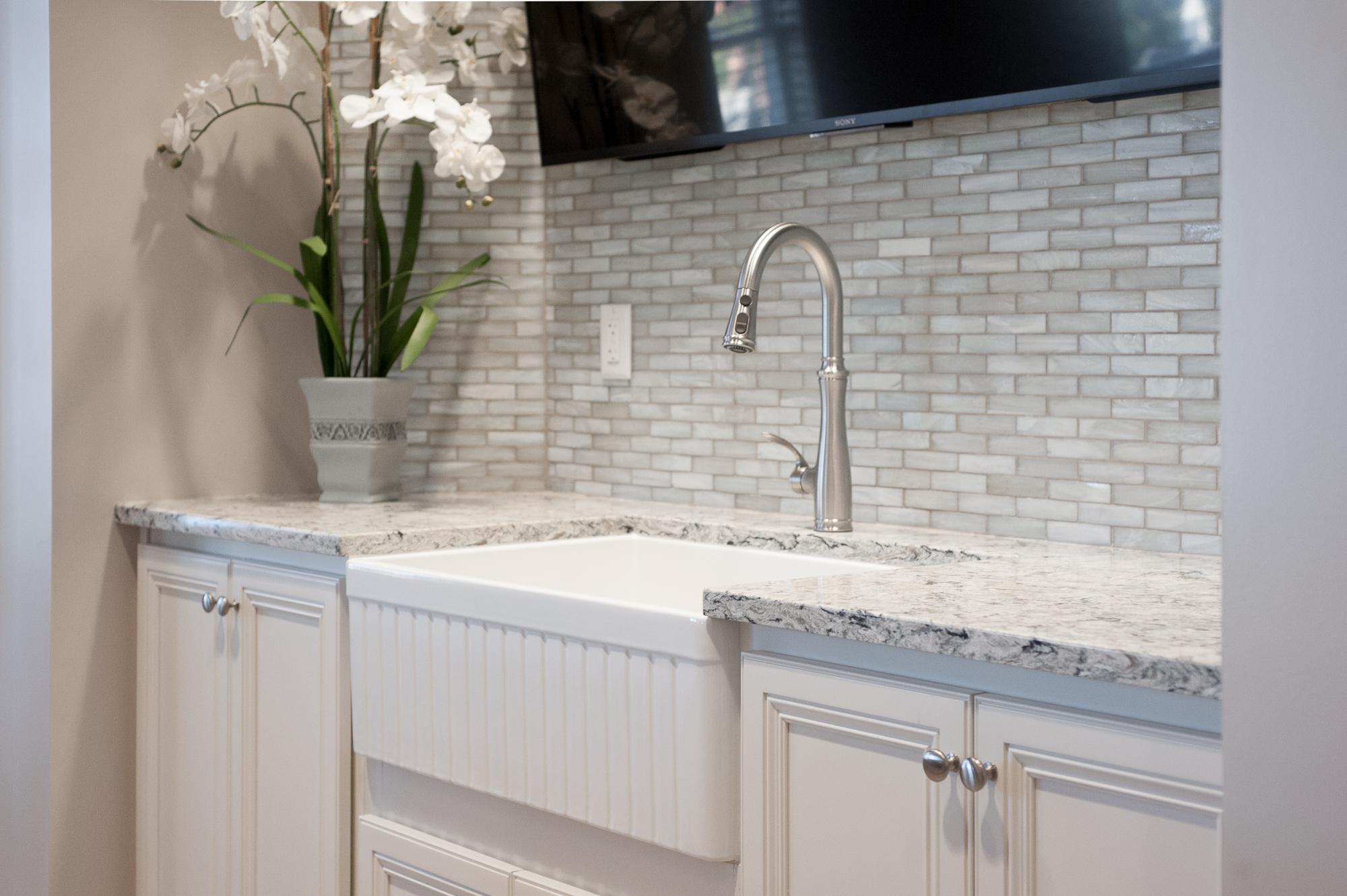 Micamy_Design_Studio_Interior_Design_Markland_StAugustine_Clubhouse_OldFlorida_Coastal_Glass_Mosaic_Tile_Backsplash_Kitchen_Cambria_Kohler_Blue_.jpg