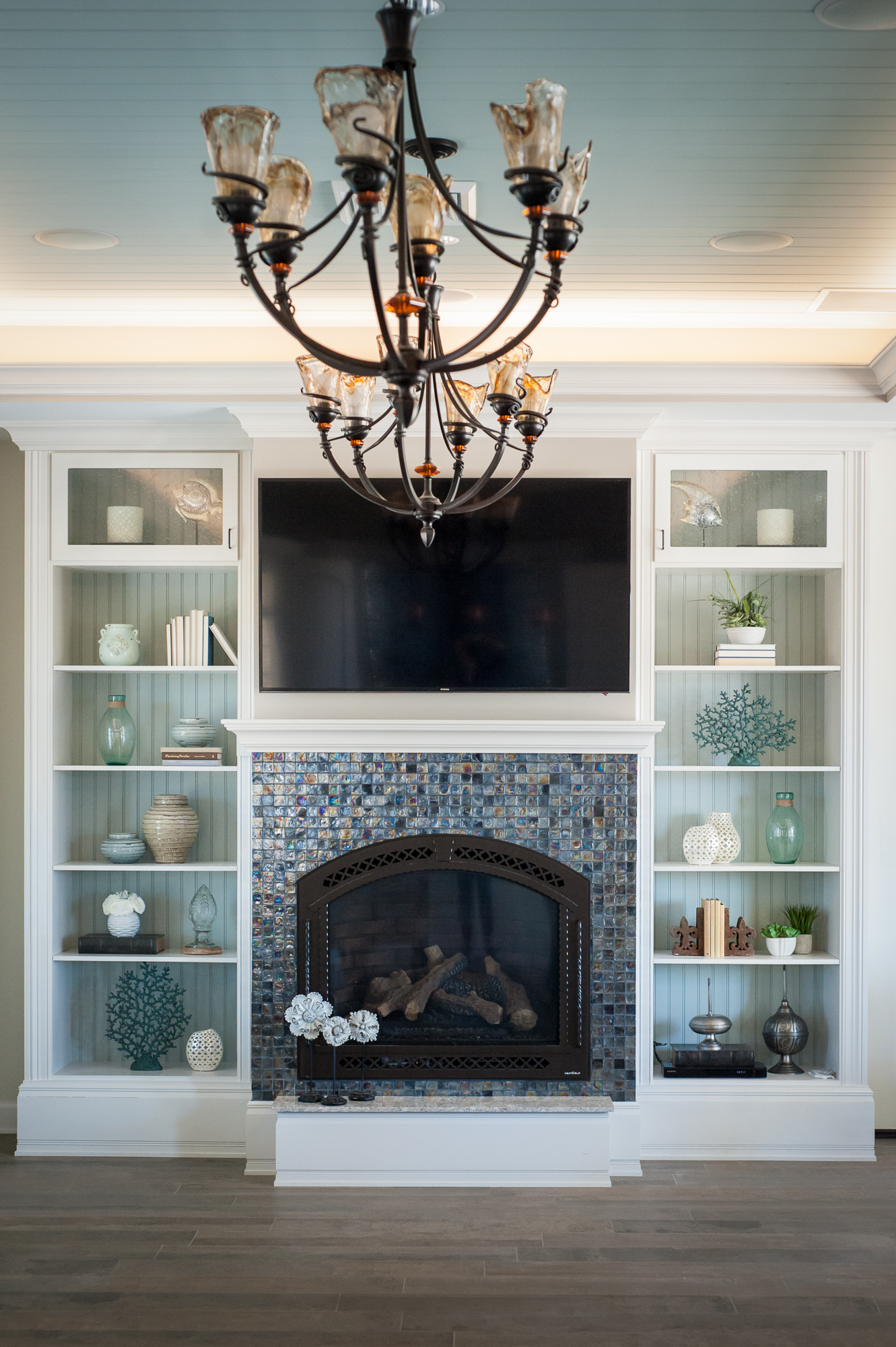 Micamy_Design_Studio_Interior_Design_Artisan_Lakes_Clubhouse_Serene_Coastal_Glass_Mosaic_Tile_Backsplash_Fireplace_SherwinWilliams_Crossville_Blue_ (2).jpg