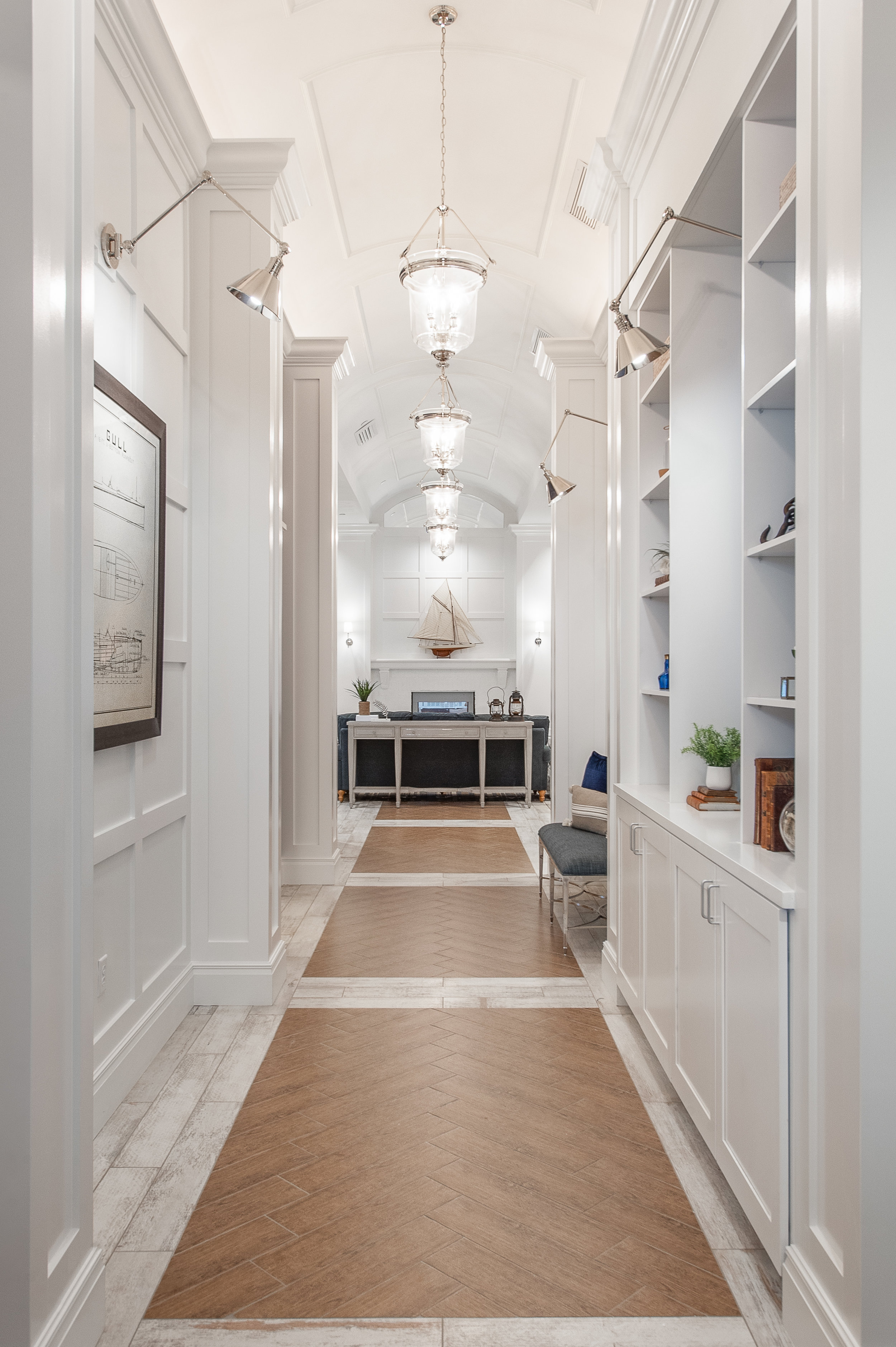 Micamy Design Studio_Interior Design_Beacon Lake_Amenity Center_Clubhouse_New England Style_Nautical_Hallway_Barrel Ceiling_Pendants_Herringbone Tile_Sconces_Ship.jpg