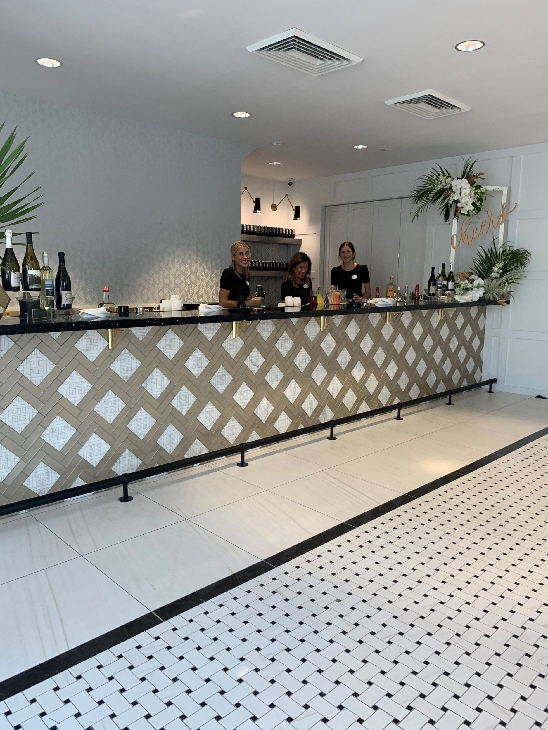 ClayTheatre_MicamyDesignStudio_Bar_Detail_Tile_GrandOpening_Party_Bartender.jpg