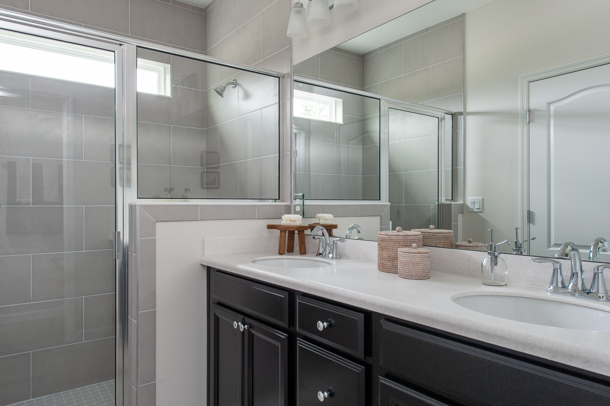 Micamy Design Studio_Model Home_Interior Design_Orchard Cove_Modern Coastal_McGee & Co_Owners Bath_Walk in Shower_Dark Cabinets.jpg