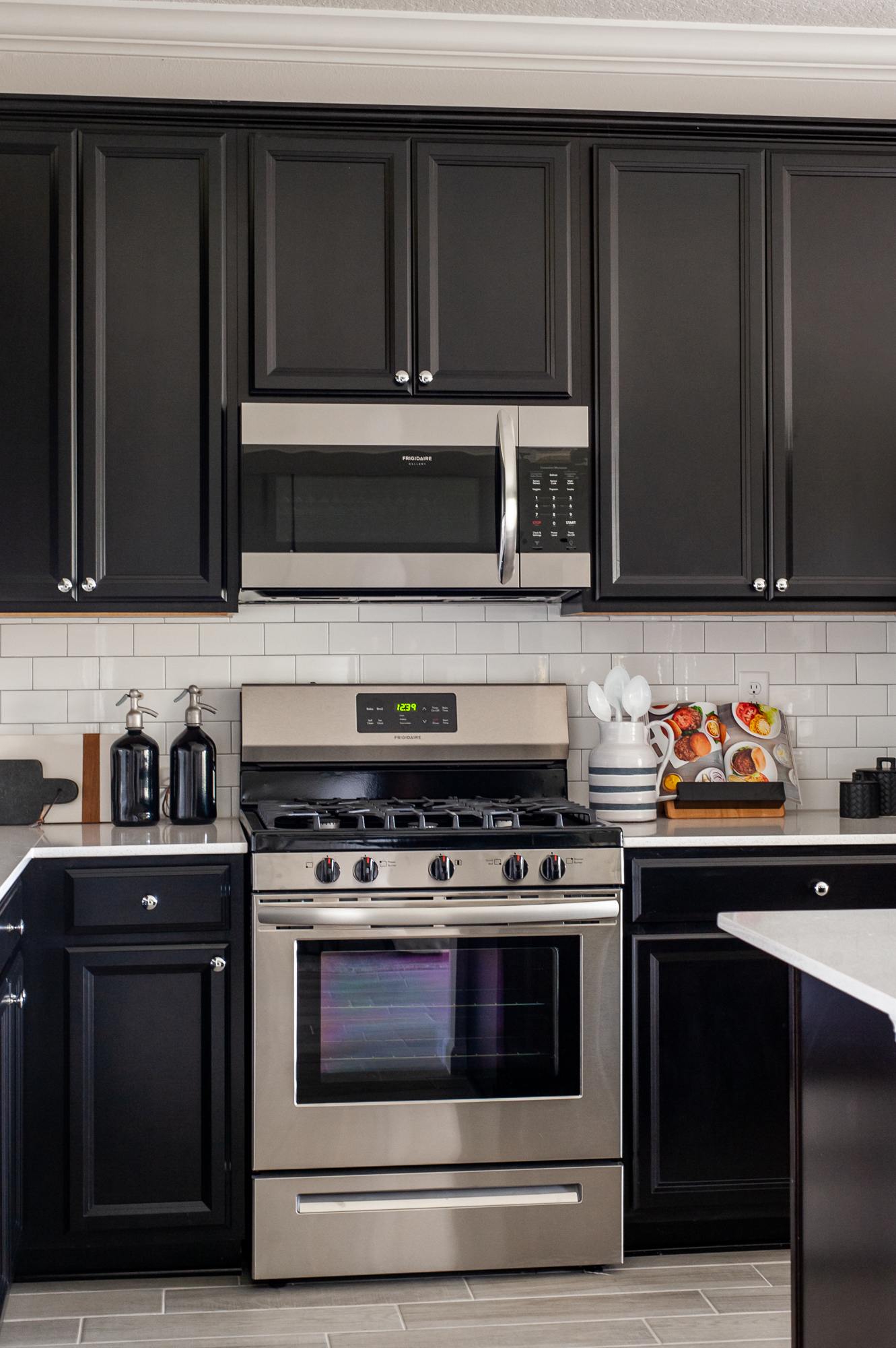 Micamy Design Studio_Model Home_Interior Design_Orchard Cove_Modern Coastal_Universal_McGee & Co_Kitchen_Dark Cabinets_Kitchen Accessories_Subway Tile.jpg