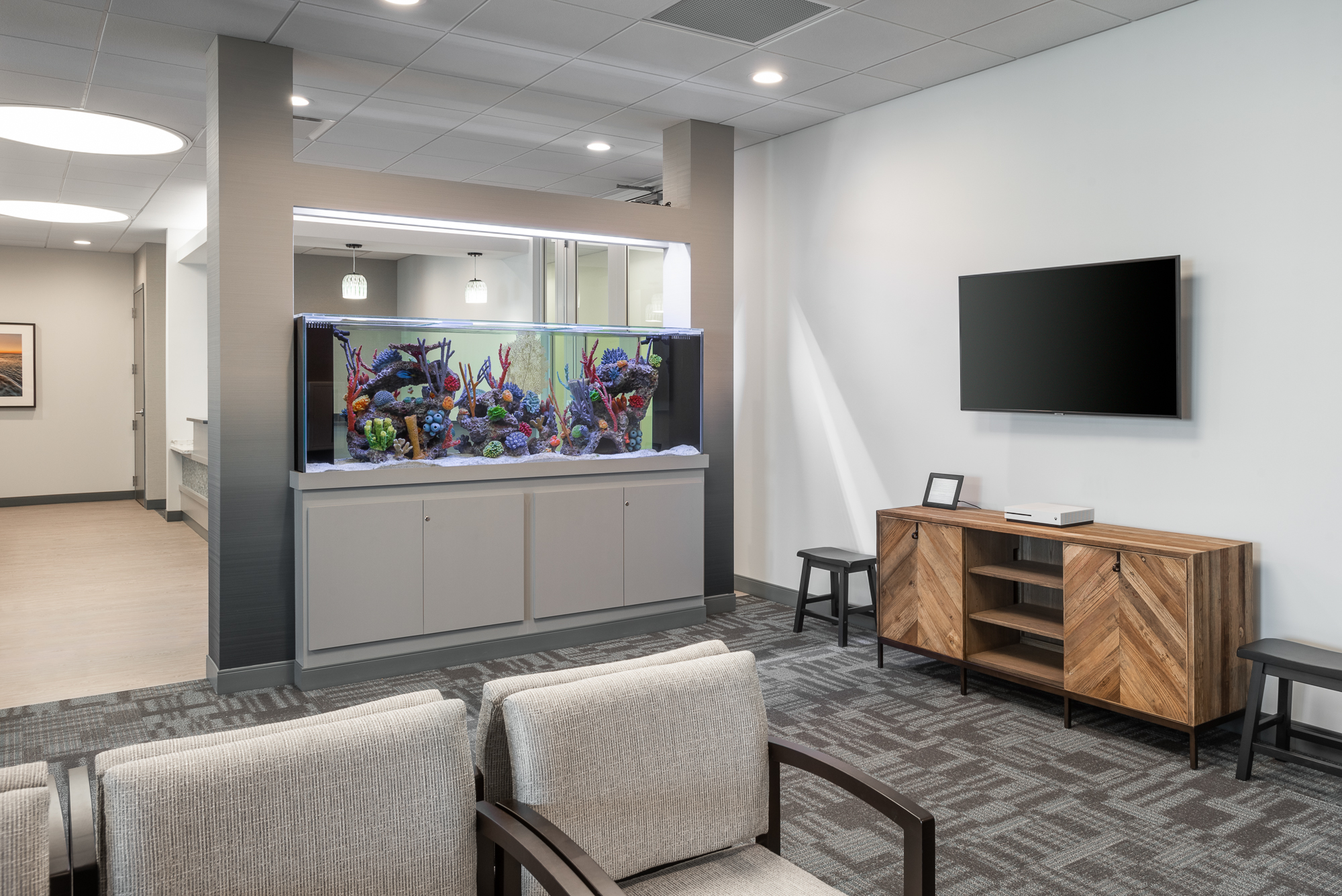 Micamy Design Studio_Interior Design_Pediatric Eye Consultants_North Florida_Riverside_Ophthalmology_Strabismus_Office__Renovation_Patcraft_Aquarium_Fish Tank_Bariatric Chair_Stance.jpg