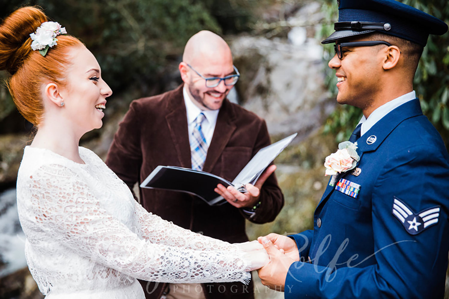 Michael DeSerio of Hearts and Bones officiating an outdoor wedding in Asheville, NC