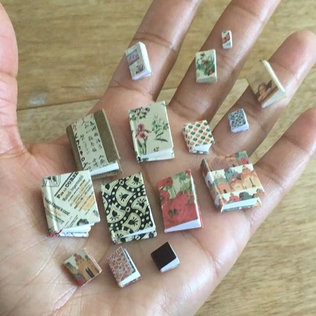 Been making some tiny books. 📚  #miniaturebooks * * * * * * #dollhouseminiatures #dollshouseminiatures #miniatures #miniature #petiteafrique #onetwelthscale #12thscale #1inchscale #handmade #handcrafted #artisanminiatures #collectibles #doll #dolls #dollshouse #dollhouse #books #book #miniaturebook #books #tinybooks #library #booklover #bookworm #bookshelf #library #notebook #notebooks #bookbinding
