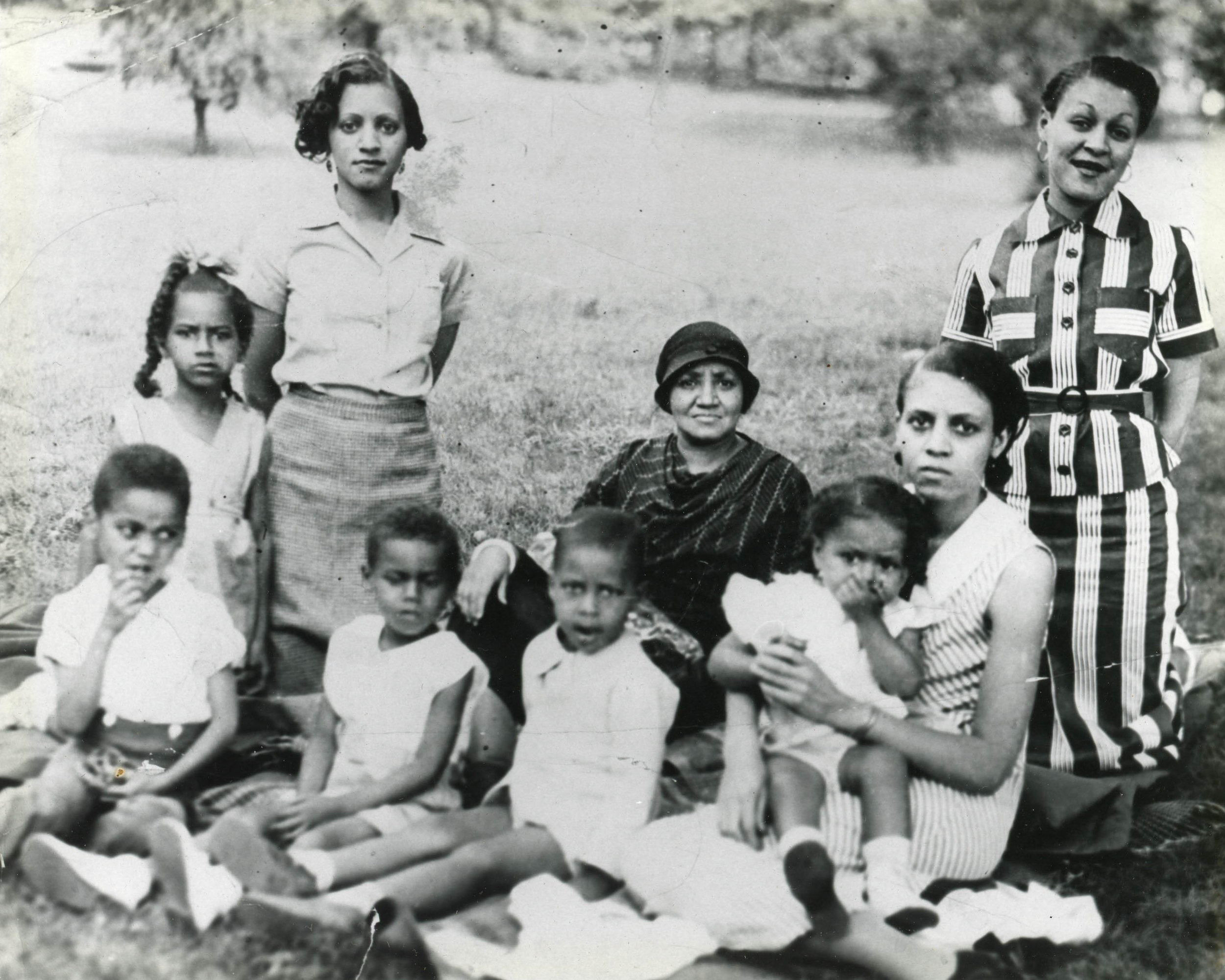 Louise Powe's family, including her mother (front row, right), aunts, grandmother, and older siblings, at a picnic in the early 1930s. Courtesy of Louise Powe.
