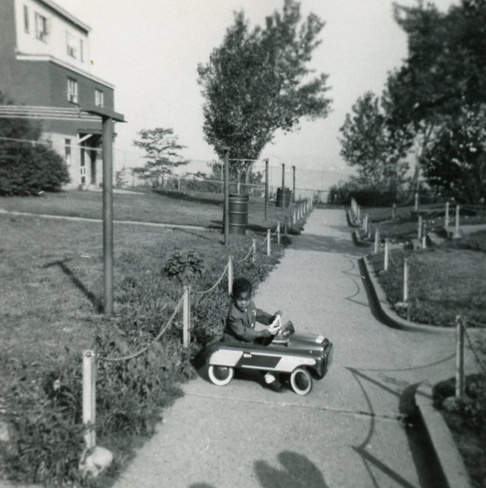 Todd Brown plays outside his family's Whiteside Road home, c. 1950s. Courtesy of Norman Brown.