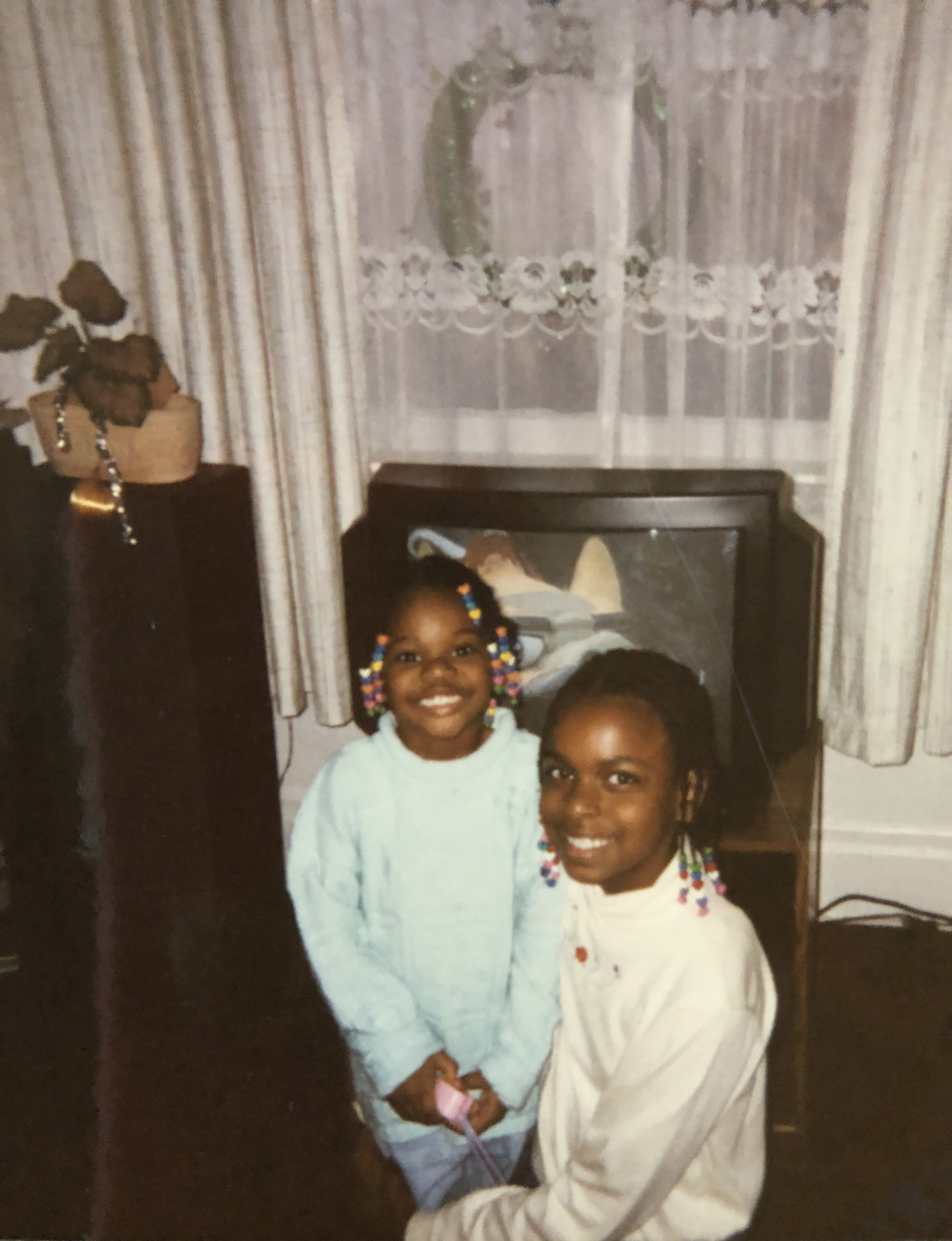 Darice Stanford (pictured, left) with her cousin in the early 1990s. Courtesy of Darice Sanford.