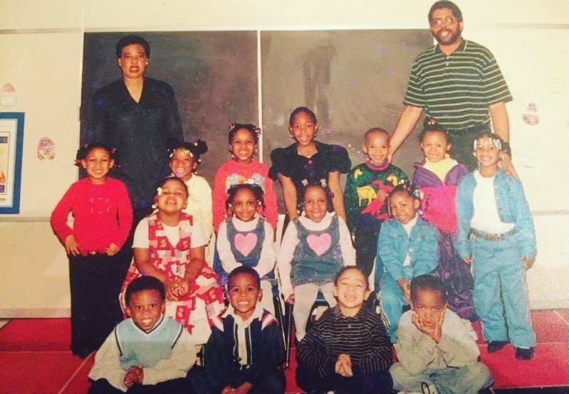 Tia Torres pictured (seated, first on the left) and her pre-school class at the Hill House in 1999. Courtesy of Tia Torres.