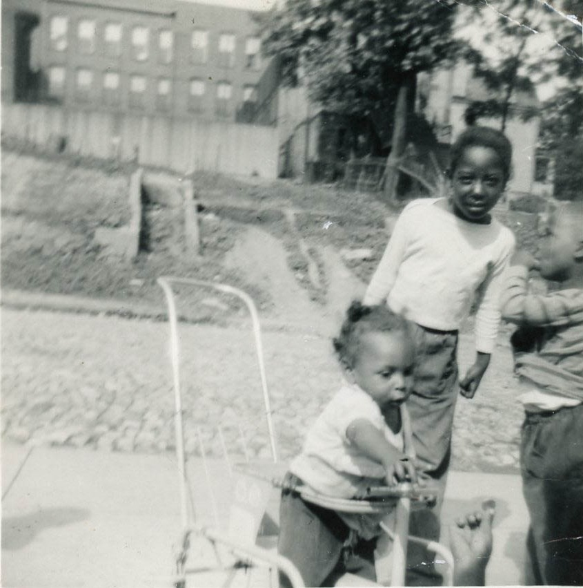 Amos Lawson (pictured, right) with his siblings in the early 1950s. Courtesy of Amos Lawson.