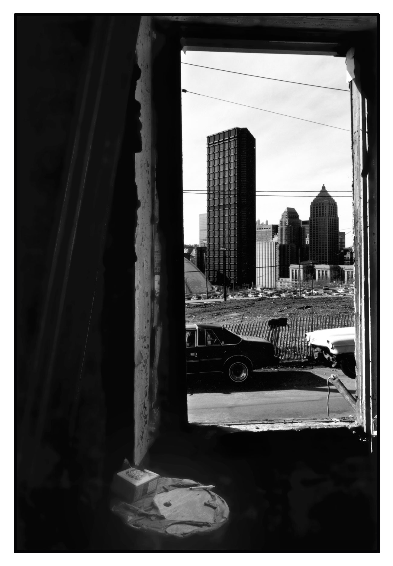 Photo taken from the house on the corner of the former Tannehill Street and Webster Avenue. Crawford Street is in the distance at the base of the dark pole, and the Civic Arena is to the left of it. Vacant buildings such as this were often used as shooting galleries. Photo by Carlos Peterson, 1990.