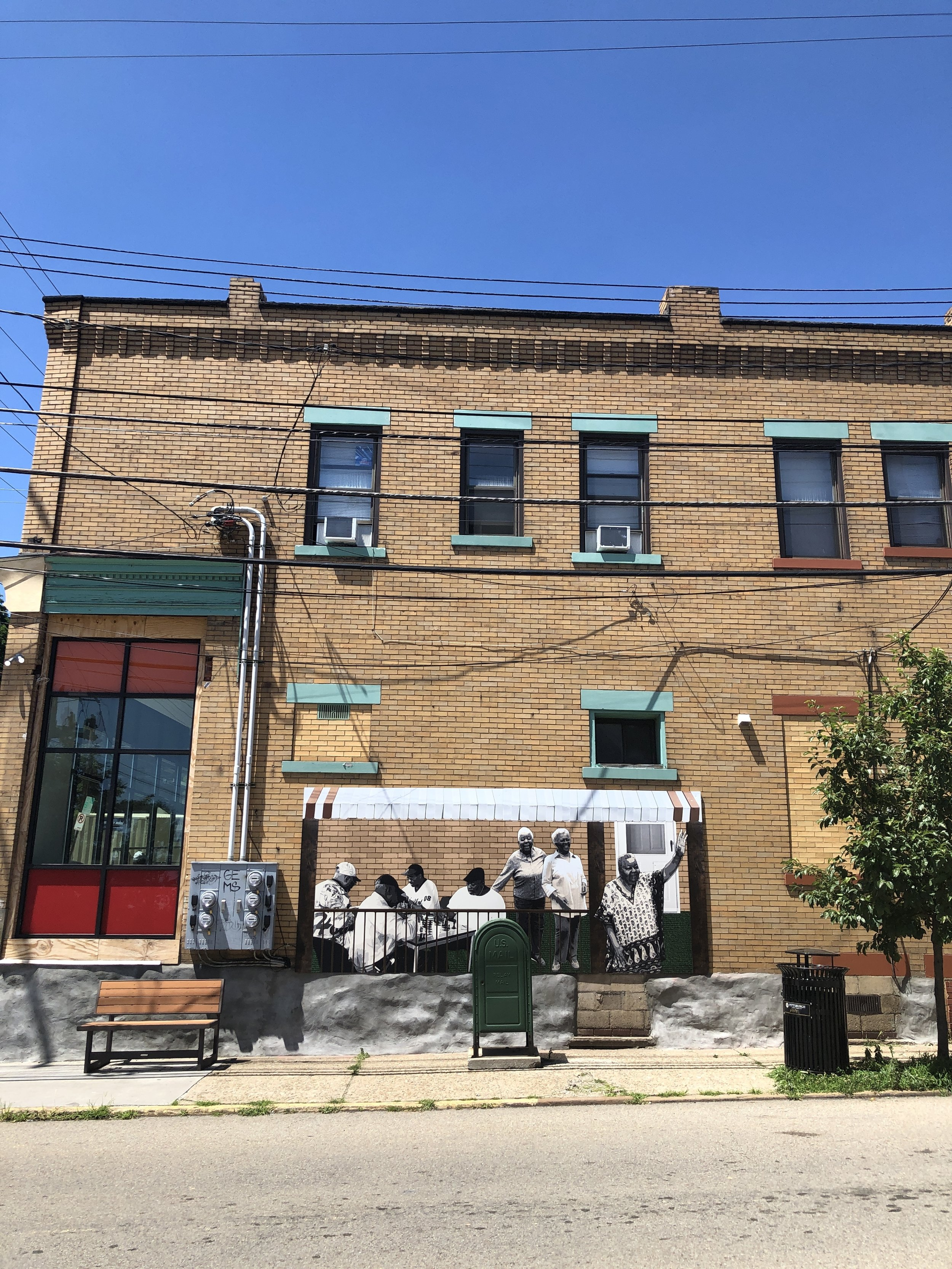 """""""The Anchors"""" is on the exterior of the community space, The Corner, and it honors the elders on the Hill who have held the neighborhood together."""