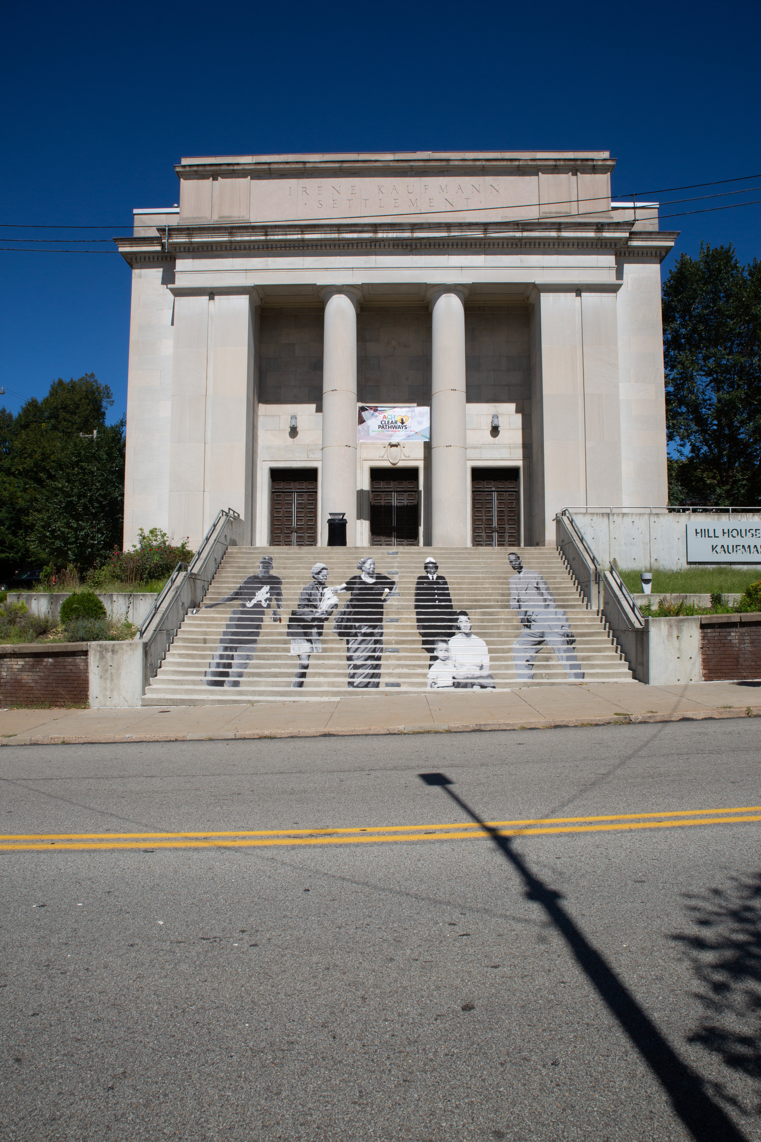 """""""The Village"""" is an installation on the stairs of the Kaufmann Auditorium, paying homage to the diversity of residents who have made the Hill what it is."""