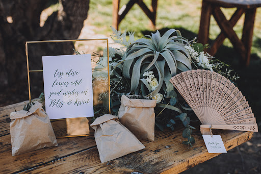 welcome table sign and olive confetti and fan.jpg