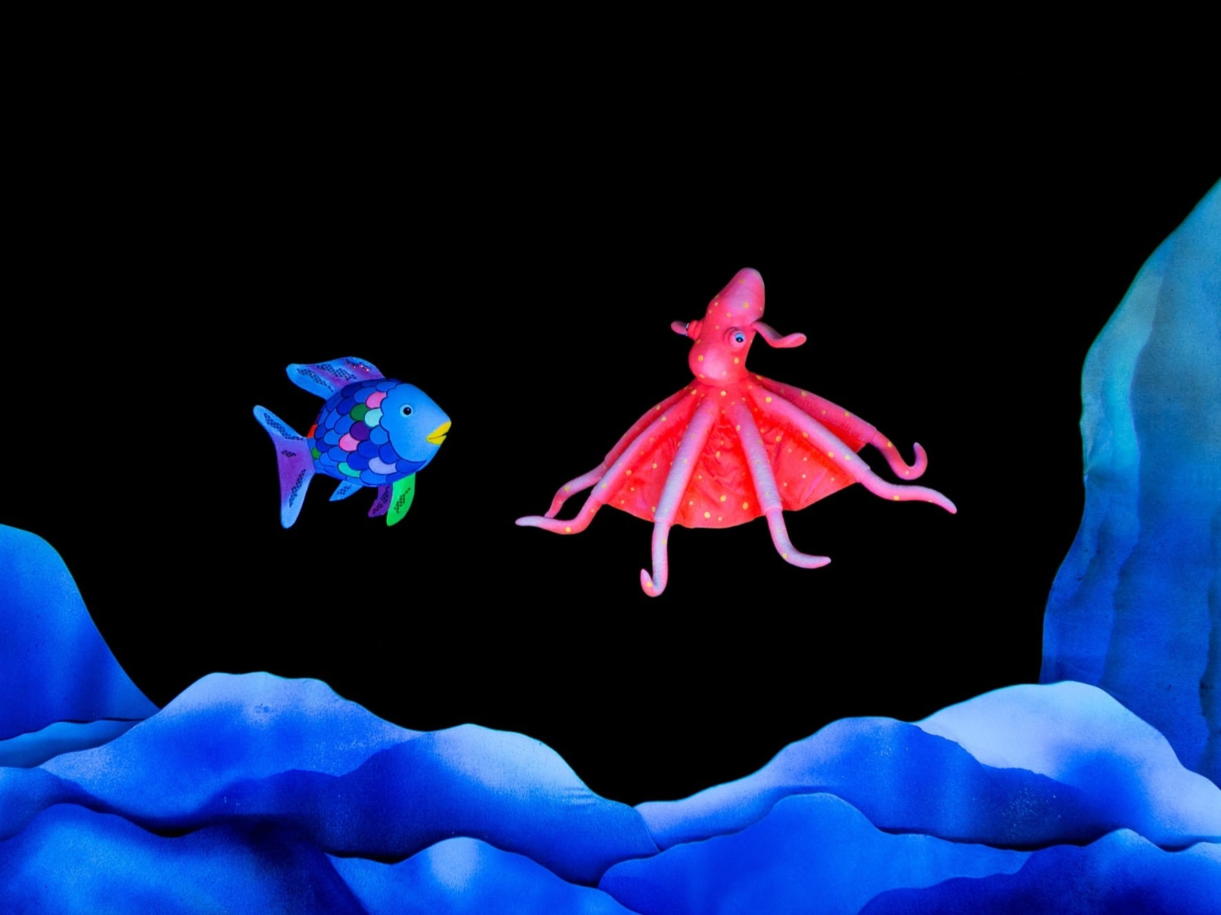 "The Rainbow FishMermaid Theatre of Nova Scotia - September 28, 2019 - 3pmAn original stage adaptation of Marcus Pfister's award-winning colourful story, The Rainbow Fish, and its companion tales, Rainbow Fish Discovers the Deep Sea and Opposites, this delightful production tells the tale of a lonely fish who doesn't want to share his most prized possession – his magnificent shiny scales.After taking the advice of a clever octopus, the fish begins to give away his much envied scales. Along the way, he finds courage to explore the great unknown deep sea, discovering a new world with wonderful sights and sounds and friendly creatures of all shapes, sizes, and colors.The story, brought to life through innovative puppetry, striking scenic effects, and evocative original music, will enchant even the youngest child as themes of opposites, friendship, responsible decision making, and relationship skills are examined.""The Mermaid Theatre puppeteers have truly mastered their puppets. If you're interested in a stunning visual performance, this is certainly a show you'll want to see."" – Jasmine Roy, St. Albert Today"