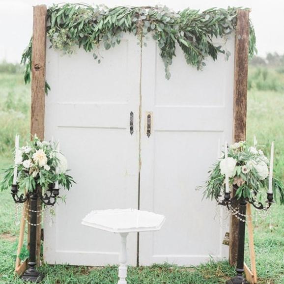 wooden-doors-with-foliage-wedding-ceremony-backdrop-ideas-by-%2540theweddingomd.jpg