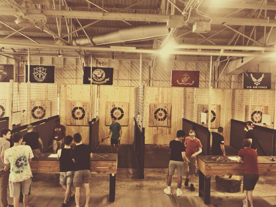 TOMMY HAWKS AXE HOUSE - SPRINGFIELD, MO   See their mobile throwing lanes at the MOORE EXPO! Axe throwing is becoming extremely popular in the United States. Thanks to our Canadian brethren, there has been a surge in the sport, spurring many different venues to start popping up around the country. Don't be fooled by the imitators, the plain Janes, and the naysayers. Come visit the only place that truly KICKS AXE!