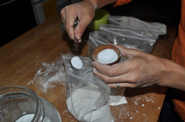 Adding sugar/salt to each prepped package.