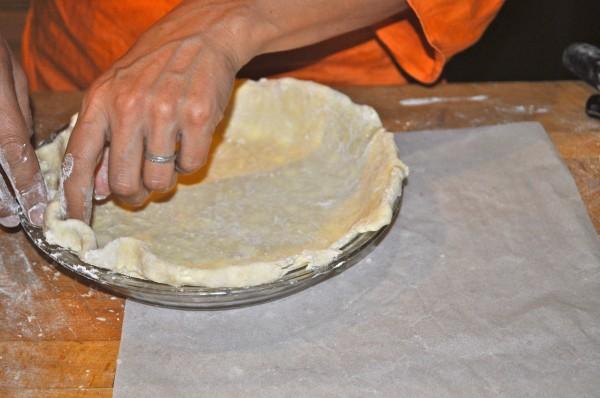 Shaping pie dough.