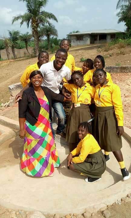 Kathy Charlie with a teacher and some of the Concrete Foundation students.