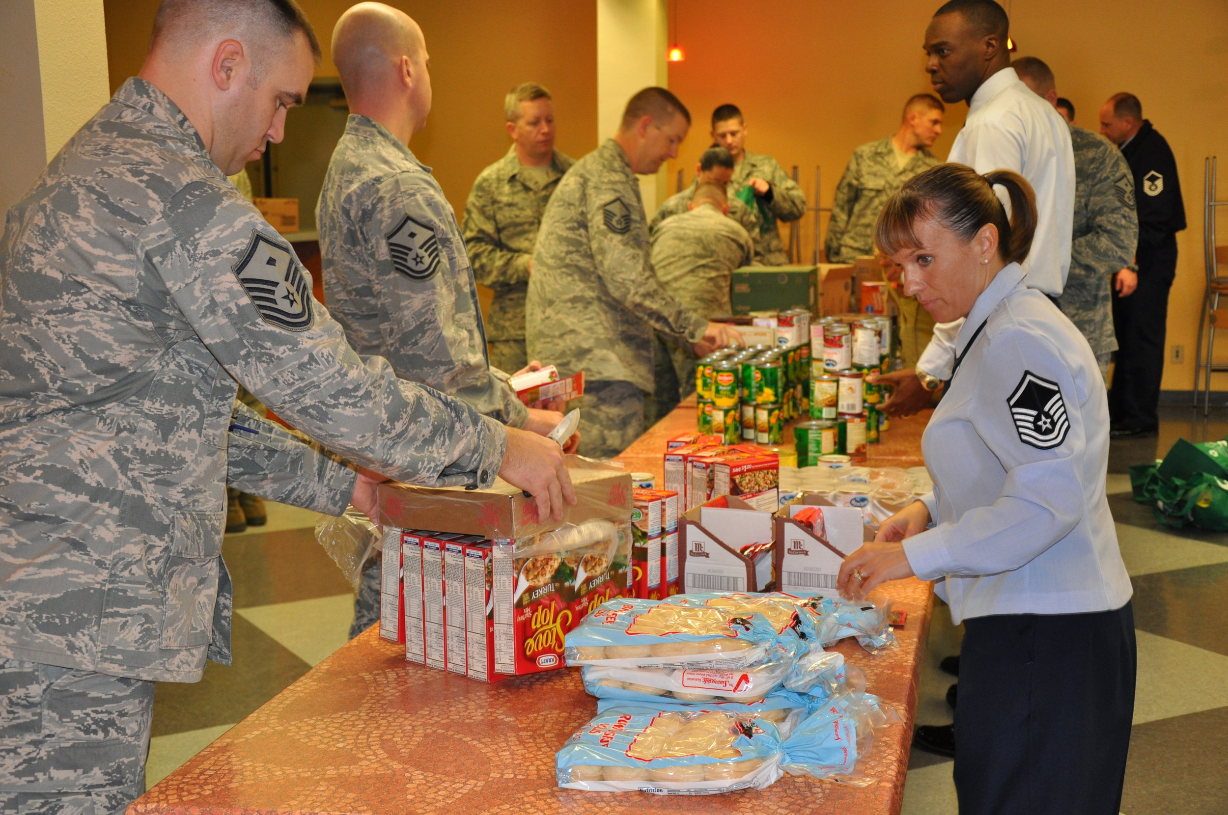 - The men and women of Operation Beale Warm Heart preparing Thanksgiving baskets for deserving families.