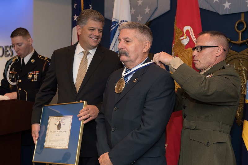 Receiving Award from Major General Daniel J. Lecce, USMC-Staff Judge Advocate to the Commandant of the Marine Corps