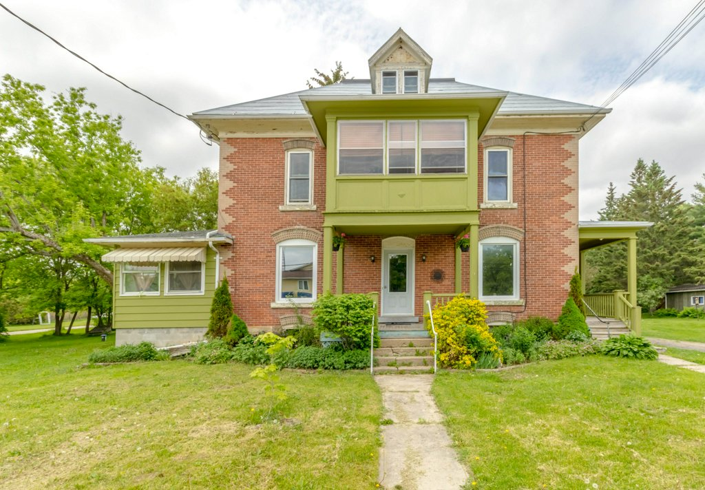 56 Main St. - A red-brick Century home on a double lot, with an in-law suite or perhaps a home office, in the pretty village of Elgin.Listed at $230,000.