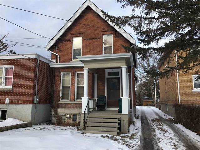 9 Balaclava St. - A Century red brick triplex on the edge of McBurney Park and just steps to the downtown shops.Listed at $395,000.