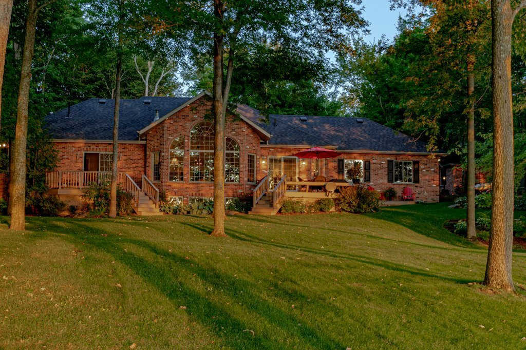 3953 Stone Point Drive - A bungalow of red-brick on the shores of Dog Lake. Something very special indeed.