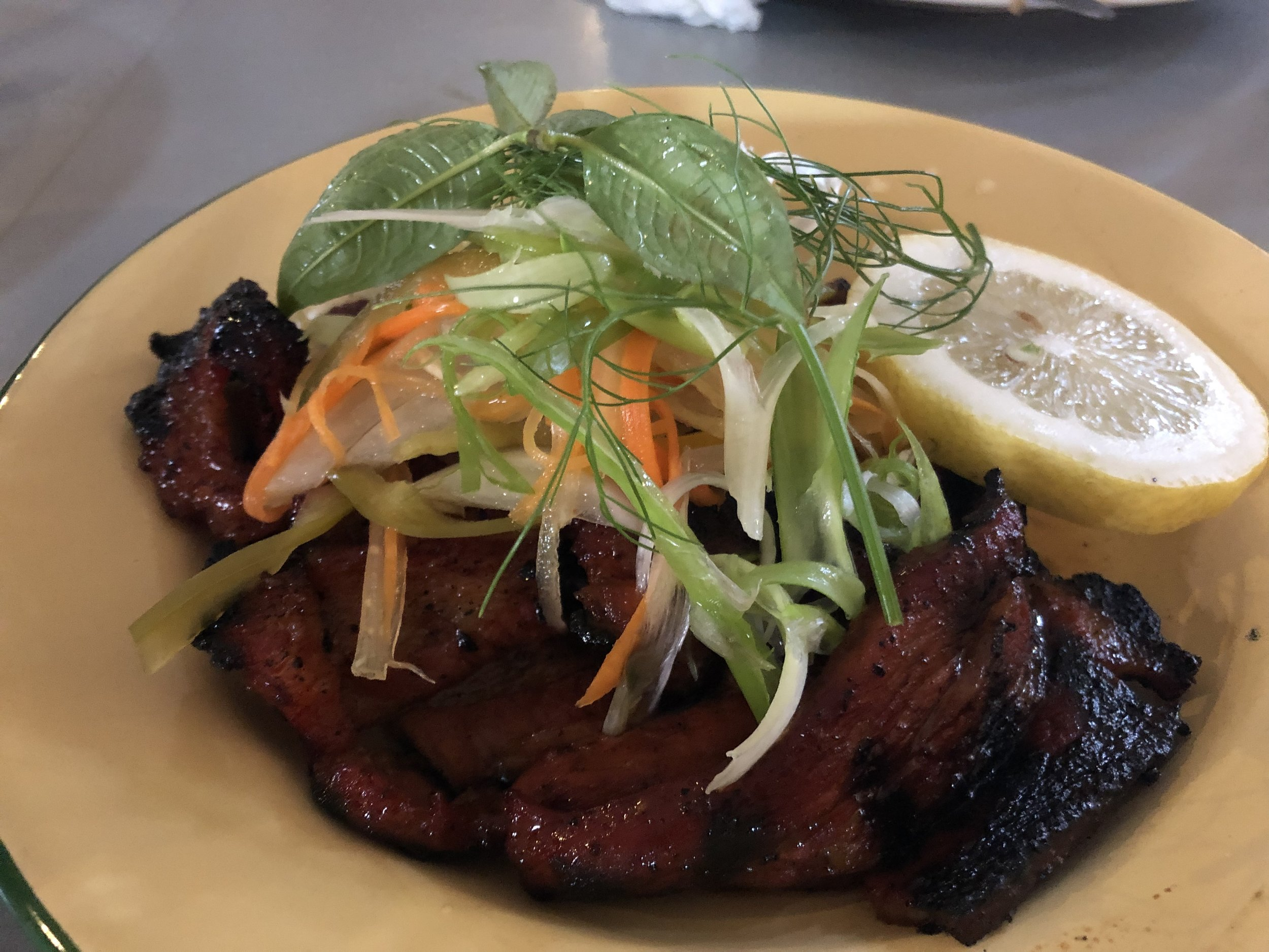 Filipino style barbecue pork with pickled paw paw