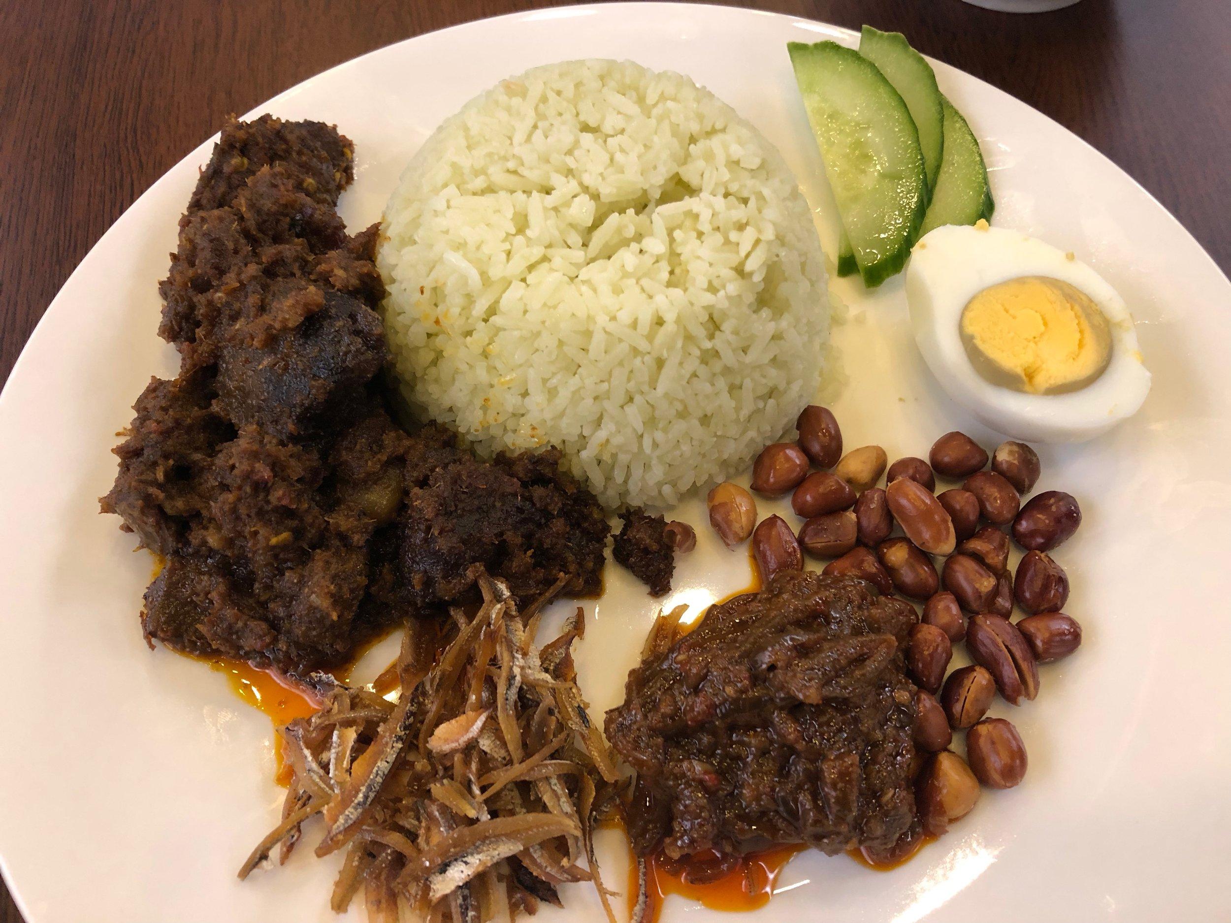 Nasi lemak with beef rendang