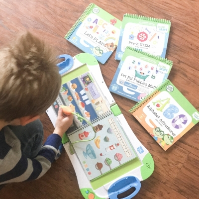 Leap Frog Leap Start - Jack seen here playing with the Leap Frog system. He has several books to choose from and they are easy to interchange. New books are definitely on his Christmas list!