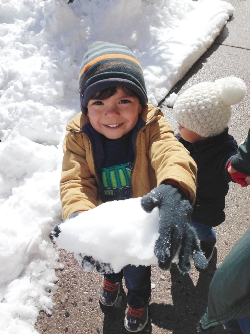 Joseph so excited about whacking people with snow chunks. Mostly he would just rub it into your back!
