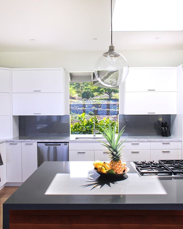 Our project in Kailua-Kona originally had a much smaller kitchen window when we started.  For such a spacious kitchen, it seemed out of place.  We designed a custom bay window which opened the view and created additional counter space behind the sink.  A small alteration with a big pay off. 
