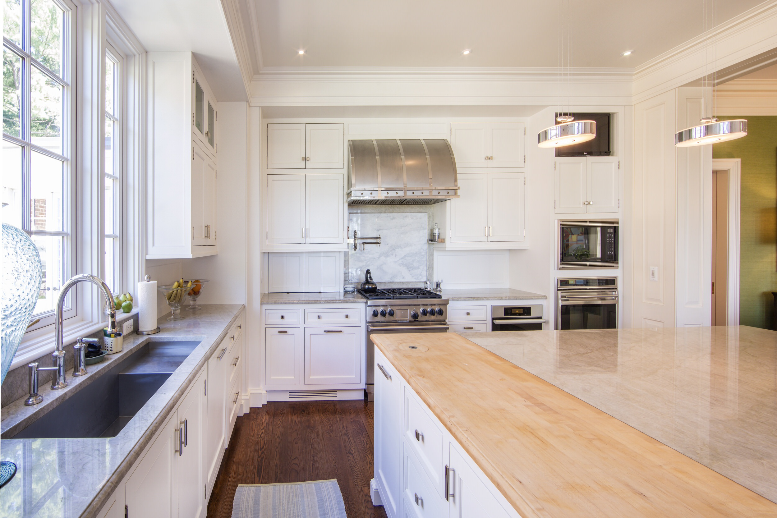 Kitchen, millwork and combination of materials for the island countertop - designed for Hamady Architects