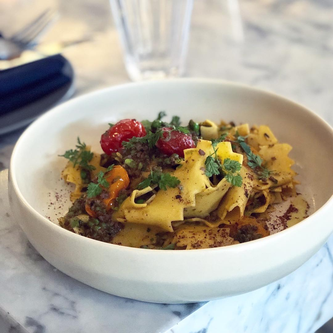 Handmade Pappardelle -  semolina pappardelle noodles, fresh mint, peas, lamb ragu, blistered cherry tomatoes.