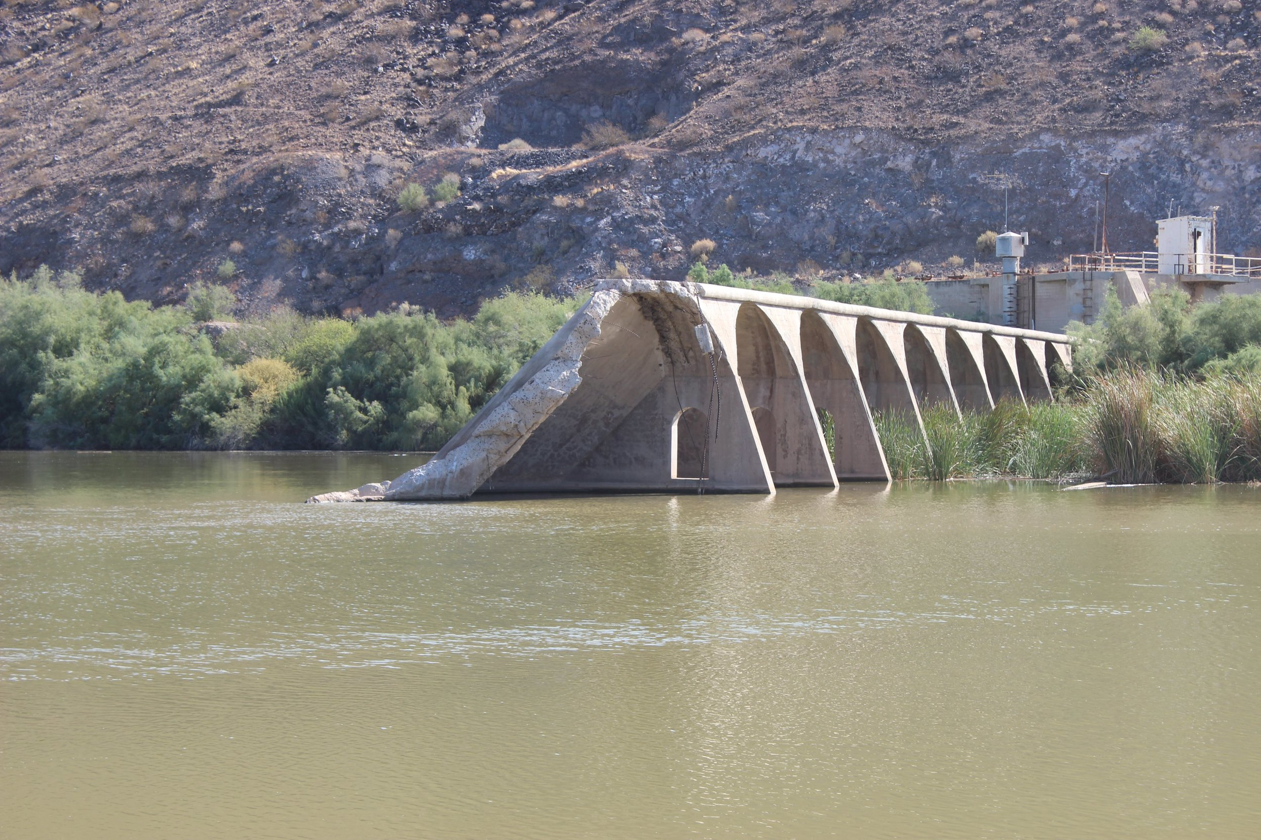 The collapsed portion of Gillespie Dam on the east bank of the Gila River